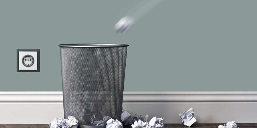Throwing paper in a waste basket
